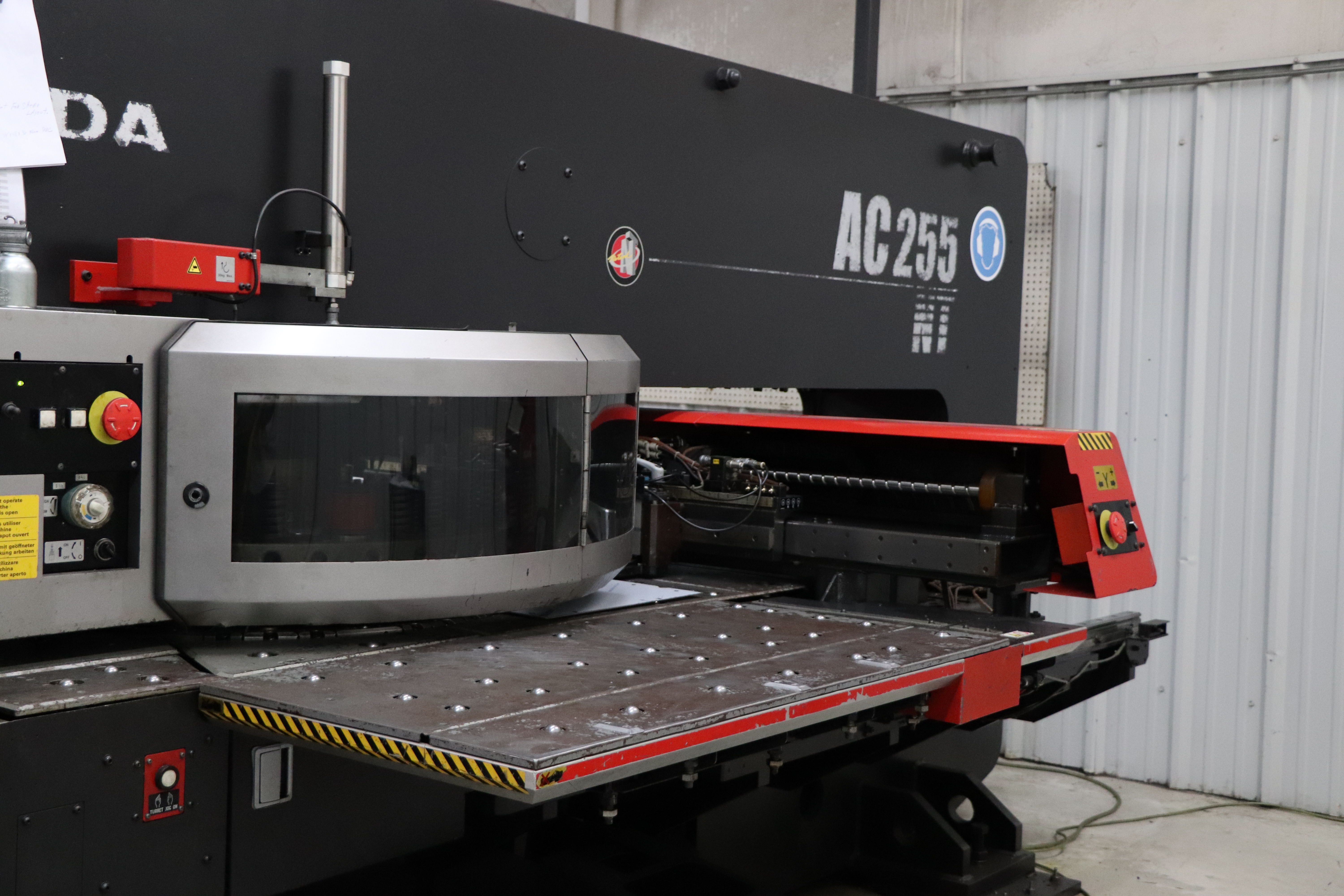 CNC punching machine during custom sheet metal fabrication process